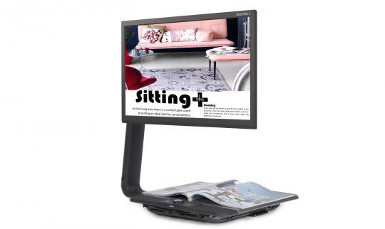 En Clearview lesetv. Disse har bøylen som holder skjermen på venstre side, i stede for bak. Dermed letter det lesing av f.eks. avis.